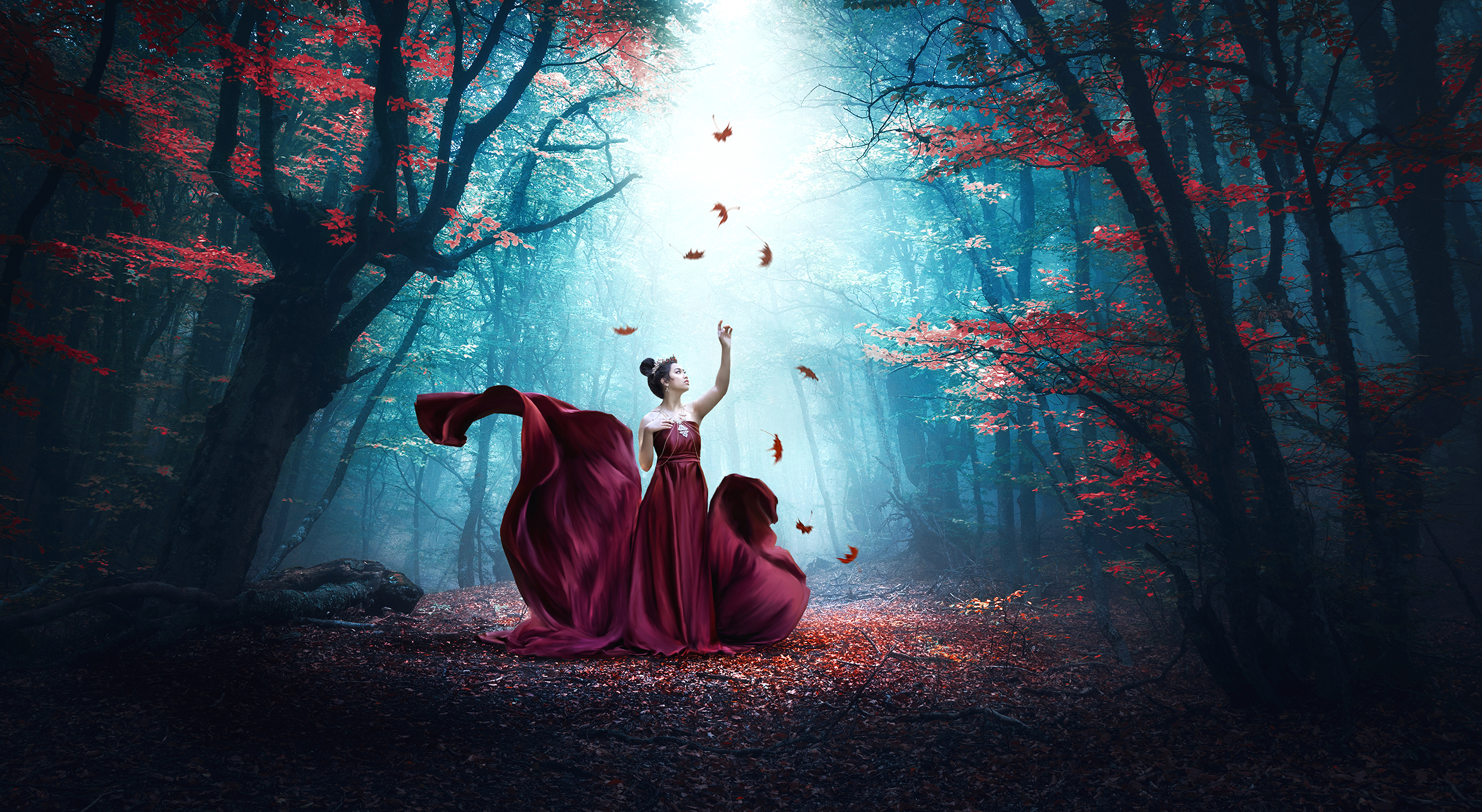 Lady in red dress in forest with leaves falling